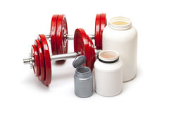 Body building - dumbbells and dietary supplements Royalty Free Stock Photography
