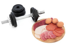 Body Building Food and Dumbbell Weights Royalty Free Stock Photos