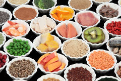 Body Building Health Foods. Body building high protein health food of meat and fish with supplement powders, grains, seeds, pulses, fruit and vegetables royalty free stock photography