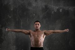 Muscular of a body building trainer Royalty Free Stock Image