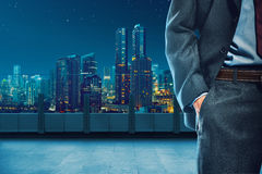 Body of business man with hand inside pocket. Over city background Stock Image