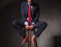 Body of a business man sitting on a chair Stock Photos