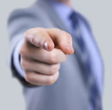 The body of a business man in a suit pointing with his finger Stock Image