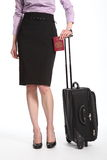 Body of business woman with passport and suitcase Stock Photos