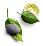 Body butter. Open jar of body cream. body butter. Stone on big green leaf. white background Royalty Free Stock Image