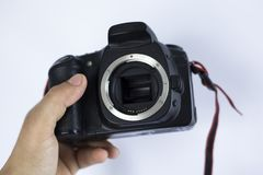 The body camera in the hands of the photographer on a white background. shoot at an old SLR camera in the studio royalty free stock images