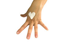 Body care. Hand with cream heart on white background Stock Photos