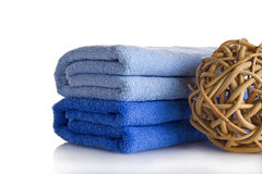 Body care. Two blue towels and a decoration ball Stock Photos