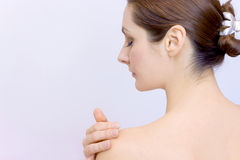 Body Care. Beautiful and young woman cherishes her body,photography Royalty Free Stock Photos