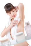 Body care: Attractive woman applying deodorant Stock Images