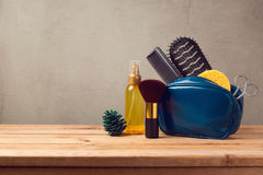 Body care and beauty products on wooden table over gray background Royalty Free Stock Photography