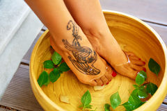 Body Care. Female Feet Spa Pedicure Procedure, Treatment. Basin,. Body Care. Female Feet In Basin, Bowl Bath With Water, Peppermint, Ginger, Essential Oil. Spa Stock Photography