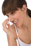 Body care - Female teenager cleaning face. With cotton pad, removing make-up Royalty Free Stock Photos