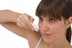 Body care - Female teenager cleaning face Stock Photography