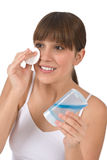 Body care - Female teenager cleaning face Stock Images