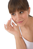 Body care - Female teenager cleaning face. With cotton pad, removing make-up Royalty Free Stock Photography