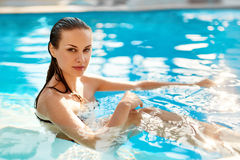 Body Care. Freshness. Woman Relaxing In Pool. Beauty, Healthy Li Royalty Free Stock Images