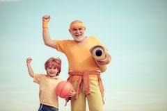 Body care and healthcare. Fitness and active lifestyle concept - copy space. Senior man and child in family health club