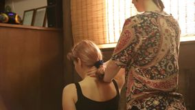 Body care and a healthy lifestyle. Professional Thai massage in spa saloon. stock video footage