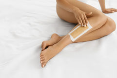 Body Care. Long Woman's Legs With Wax. Depilation Concept Stock Images