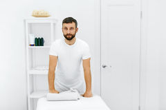 Body Care. Masseur In Spa Salon. Physical Therapist. Massage The. Body Care. Portrait Of Masseur Standing By Massage Table In Spa Salon. Physical Therapist In Stock Photo