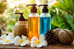 Body care product,shower and shampoo. With plumeria flower on nature background Royalty Free Stock Image