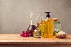 Body care products and aromatic essence oil bottle. On wooden table Royalty Free Stock Photography