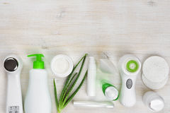 Body care products on wooden background with copyspace at top Royalty Free Stock Images