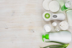 Body care products on wooden background with left side copyspace Royalty Free Stock Images