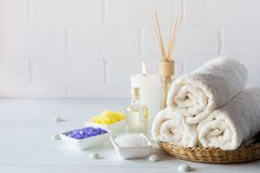 Body care set for peeling. With towel,white lily, sea salt, bath oil, sugar body scrub, massage brush. And candle Stock Photography
