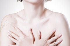 Body care, skin peeling breast. Body care, skin peeling. Massaging the breast Royalty Free Stock Image