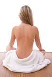 Body care at spa. Body care and beauty concept at the spa with beautiful woman Royalty Free Stock Photo
