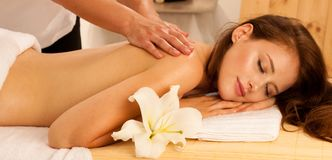 Body care. Spa body massage treatment. Woman having massage in t royalty free stock images