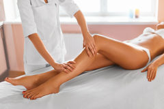 Body care. Spa treatment. Massage of human legs in spa salon Royalty Free Stock Images
