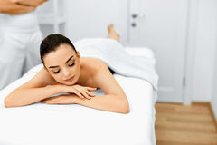 Body Care. Spa Woman. Beauty Treatment. Body Massage, Spa Salon. Body Care. Spa Woman. Beauty Treatment Concept. Masseur Gong To Do Hand Massage On Relaxed Royalty Free Stock Photos