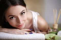 Body Care. Spa Woman. Beauty Treatment Concept. Beautiful Health. Y Caucasian Girl Relaxing On Massage Table Before Hand Massage On Relaxed Back In Health And Royalty Free Stock Photography