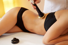 Body Care. Ultrasound Cavitation Body Contouring Treatment. Ant Royalty Free Stock Photo