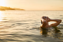 Body Care. Woman Enjoying Sea, Sunset. Healthy Lifestyle. Summer Stock Photos