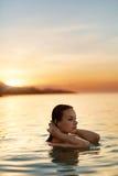Body Care. Woman Enjoying Sea, Sunset. Healthy Lifestyle. Summer Stock Photo