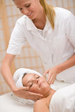 Body care - woman at face massage Stock Photography