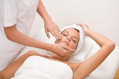 Body care - woman at face massage. In spa center Royalty Free Stock Photography
