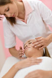 Body care - Woman luxury facial massage Royalty Free Stock Photos