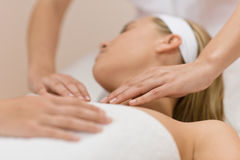Body care - Woman luxury facial massage Stock Images
