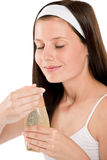 Body care - woman smelling shampoo Stock Photo