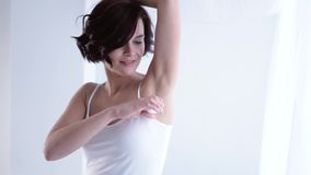 Body Care. Woman Using Ball Deodorant For Armpit Skin. Young Female Applying Antiperspirant On Underarms stock video