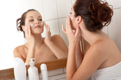 Body care - Young woman apply cream Royalty Free Stock Images