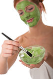 Body care - Young woman apply facial mask royalty free stock images