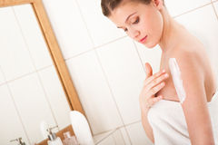Body care - Young woman apply lotion Royalty Free Stock Photo