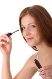 Body care - Young woman apply mascara Stock Photos