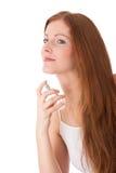 Body care - Young woman apply perfume. Body care - Young red hair woman apply perfume on white background Stock Photos